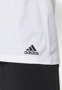 adidas Performance - ESSENTIALS TRAINING SPORTS SHORT SLEEVE TEE - Print T-shirt - black/white - 5