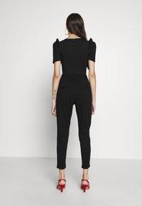 ONLY Petite - ONLPOPTRASH EASY COLOUR PANT - Trousers - black - 2
