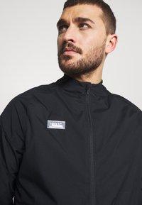 Nike Performance - Training jacket - black/black/white/clear - 3