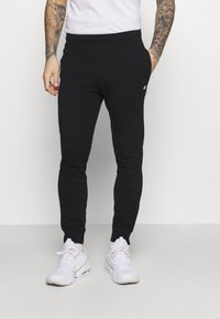 Champion - CUFF PANTS - Tracksuit bottoms - black - 0