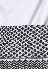 CECILIE copenhagen - BASIC TROUSERS - Trousers - black/white - 5