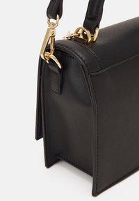 ALDO - YAEWIA - Handbag - black/gold - 3