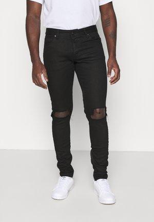 MITU DISTRESSED - Slim fit jeans - black