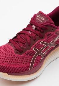 ASICS - GLIDERIDE - Neutral running shoes - rose petal/breeze - 5