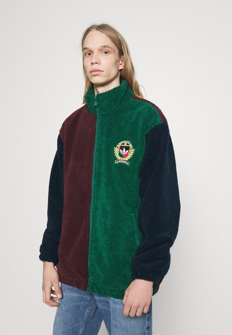 adidas Originals - COLLEGIATE CREST TEDDY TRACK JACKET - Light jacket - green/maroon/conavy