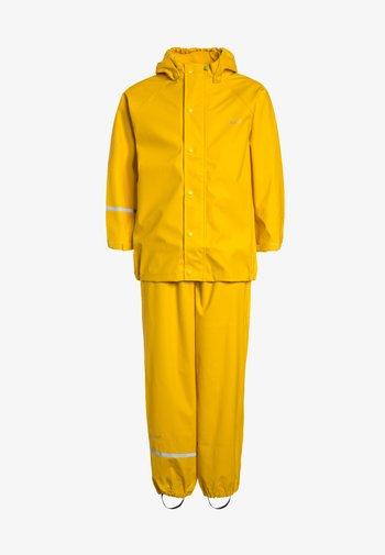 SET UNISEX - Rain trousers - yellow