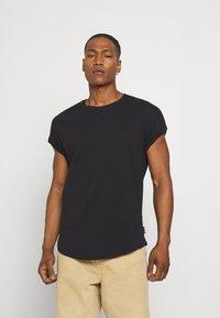 YOURTURN - UNISEX - Basic T-shirt - black - 0