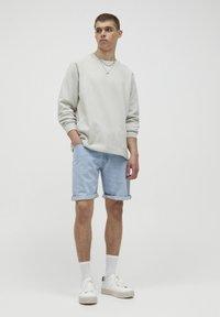 PULL&BEAR - Jeans Short / cowboy shorts - blue-black denim - 1