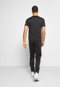 Champion - LEGACY TAPE CUFF PANTS - Tracksuit bottoms - black - 2