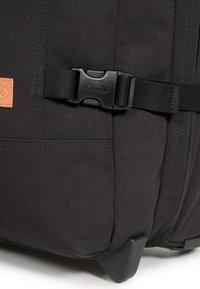Eastpak - TRANVERZ S SUPERGRADE  - Wheeled suitcase - black - 4