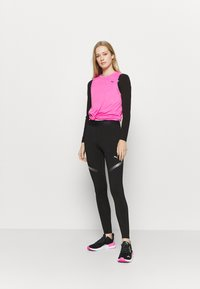 Puma - RUNNER REGULAR RISE FULL - Leggings - black - 1