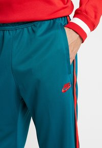 Nike Sportswear - PANT TRIBUTE - Tracksuit bottoms - geode teal/university red - 3