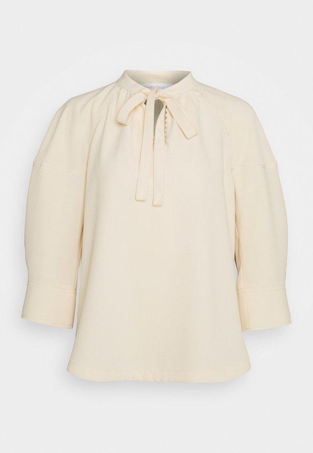 Bluzka - angora beige