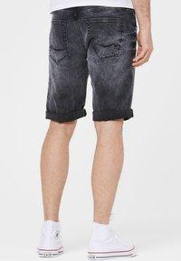 Harlem Soul - Denim shorts - blue black used - 2