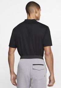 Nike Golf - DRY VICTORY - Funkční triko - black/white - 2