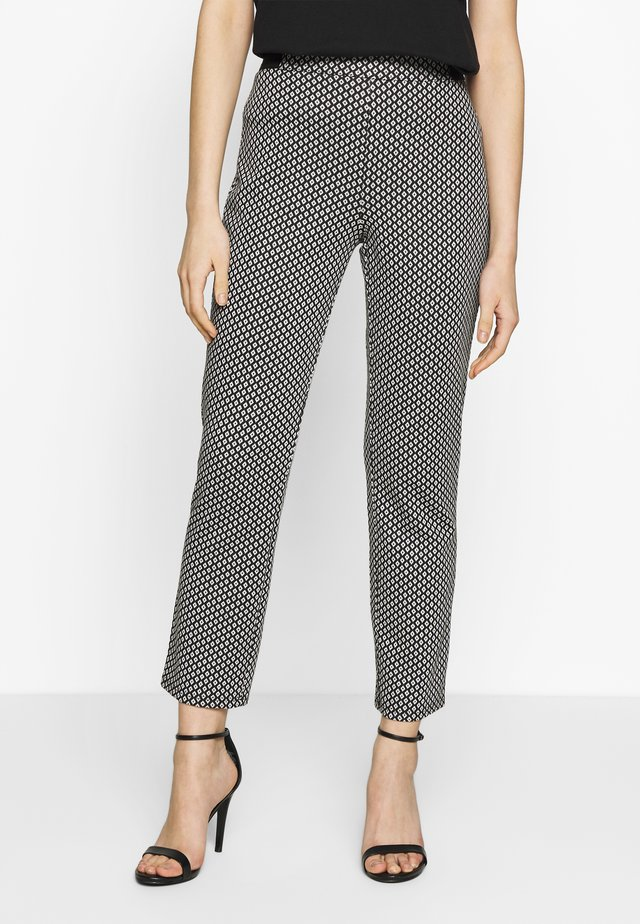 TAPERED TROUSER - Trousers - black/white