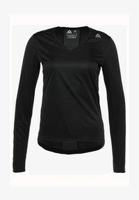 Reebok - TEE - Sports shirt - black - 4