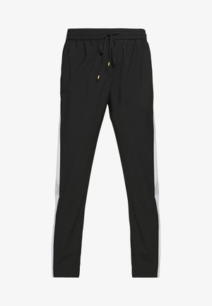 TULIPAKA - Tracksuit bottoms - black