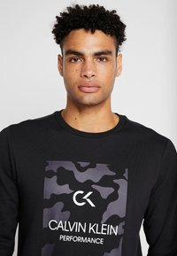 Calvin Klein Performance - BILLBOARD - Sweatshirt - black/bright white - 5