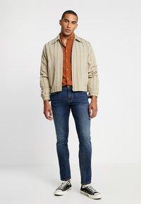 camel active - HOUSTON - Straight leg jeans - dark blue denim - 1