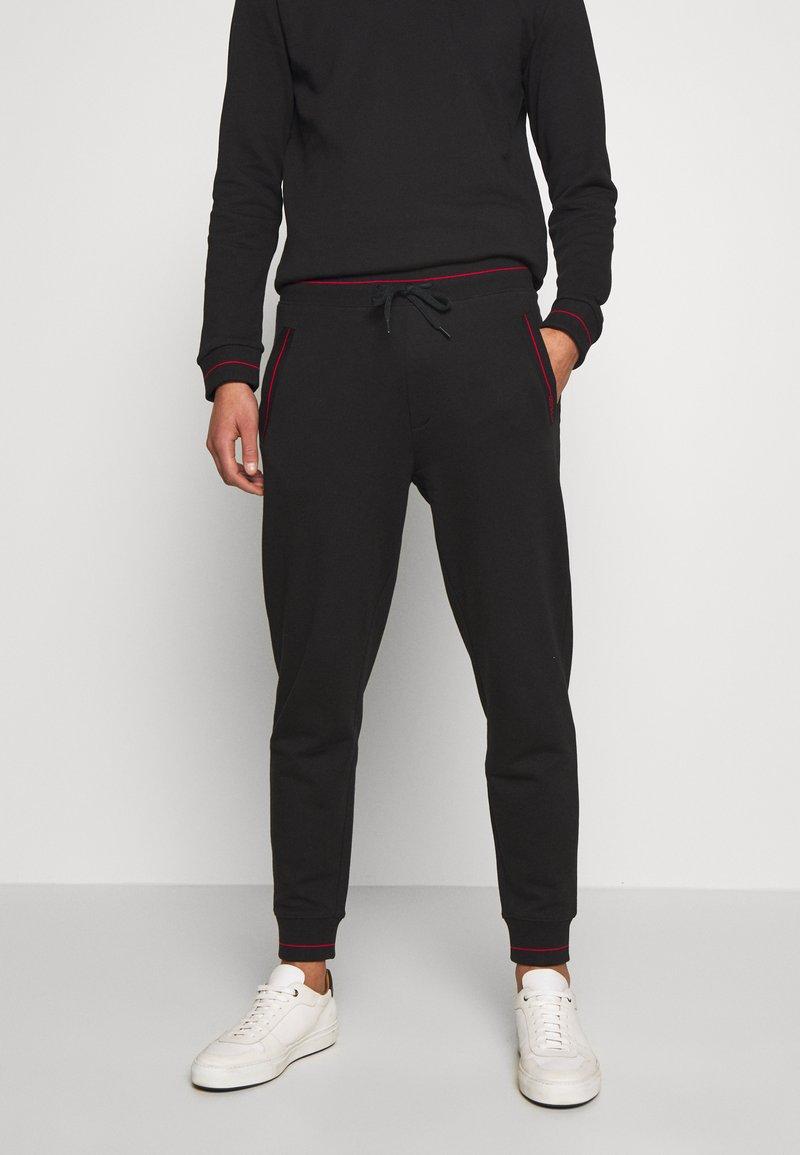 HUGO - DOAK - Teplákové kalhoty - black