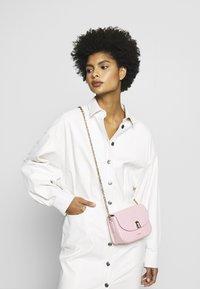 Furla - MINI BODY - Across body bag - rosa chiaro - 1