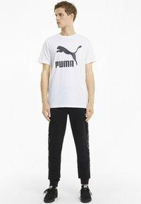 Puma - Tracksuit bottoms - cotton black - 1