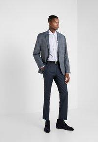 HUGO - HESTEN - Suit trousers - dark blue - 1