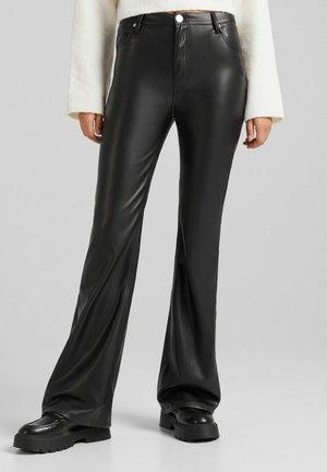 AUS  - Trousers - black
