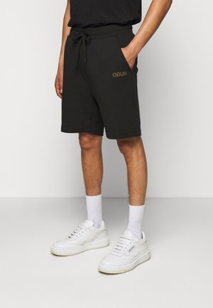 DOSHI - Shorts - black/gold