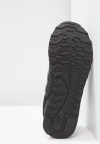 New Balance - GW500 - Sneaker low - black/gold - 5