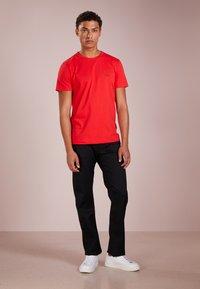 BOSS - MAINE - Straight leg jeans - black - 1