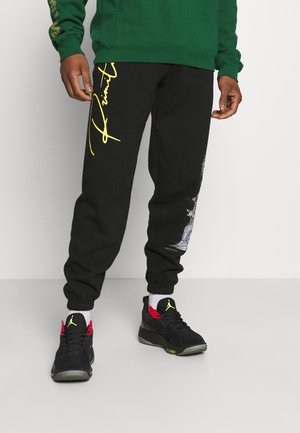 WOLVERINE - Tracksuit bottoms - black