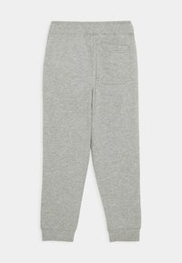 Nike Sportswear - JOGGER UNISEX - Trainingsbroek - dark grey heather/white - 1
