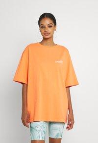 WRSTBHVR - CIRCLE WASHED WOMEN - T-shirt imprimé - orange - 2