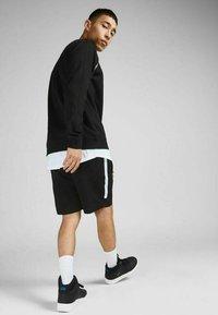 Jack & Jones - Sports shorts - black - 2
