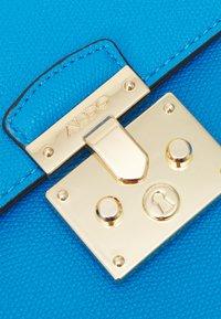 ALDO - CRIWIEL - Across body bag - diva blue/gold-coloured - 5