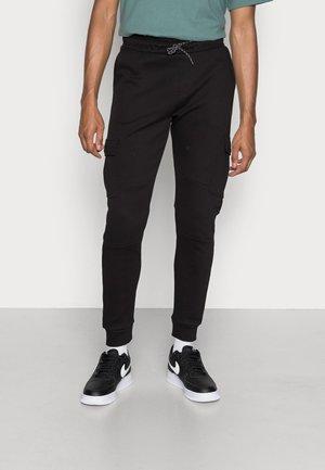DUSHANE - Pantaloni cargo - black