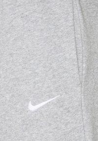 Nike Sportswear - Tracksuit bottoms - grey heather/white - 2