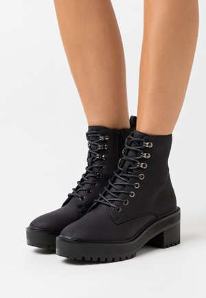 VMTESS BOOT - Platform ankle boots - black/plain