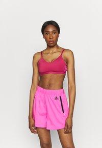 adidas Performance - BRA - Reggiseno sportivo con sostegno leggero - wild pink/screaming pink - 0