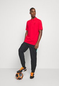 Nike Performance - FC LIVERPOOL PANT - Tracksuit bottoms - black/hyper turquoise/university red - 1