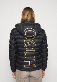 HUGO - BALIN - Veste mi-saison - black/gold