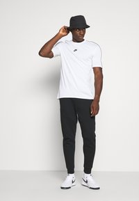 Nike Sportswear - M NSW TCH FLC JGGR - Tracksuit bottoms - black - 1