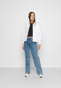 Calvin Klein Jeans - LOGO TRIM TEE - Print T-shirt - ck black - 1