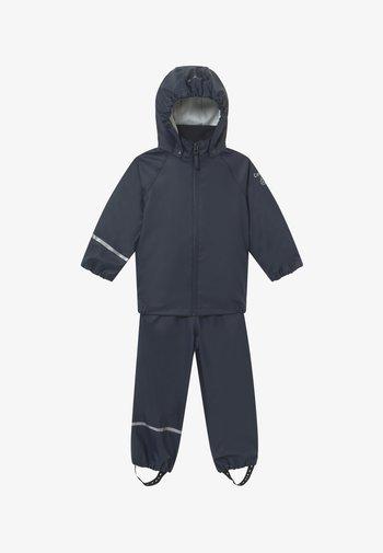 BASIC RAINWEAR SET UNISEX - Rain trousers - dark navy
