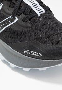 New Balance - NITREL V4 - Trail running shoes - black - 5