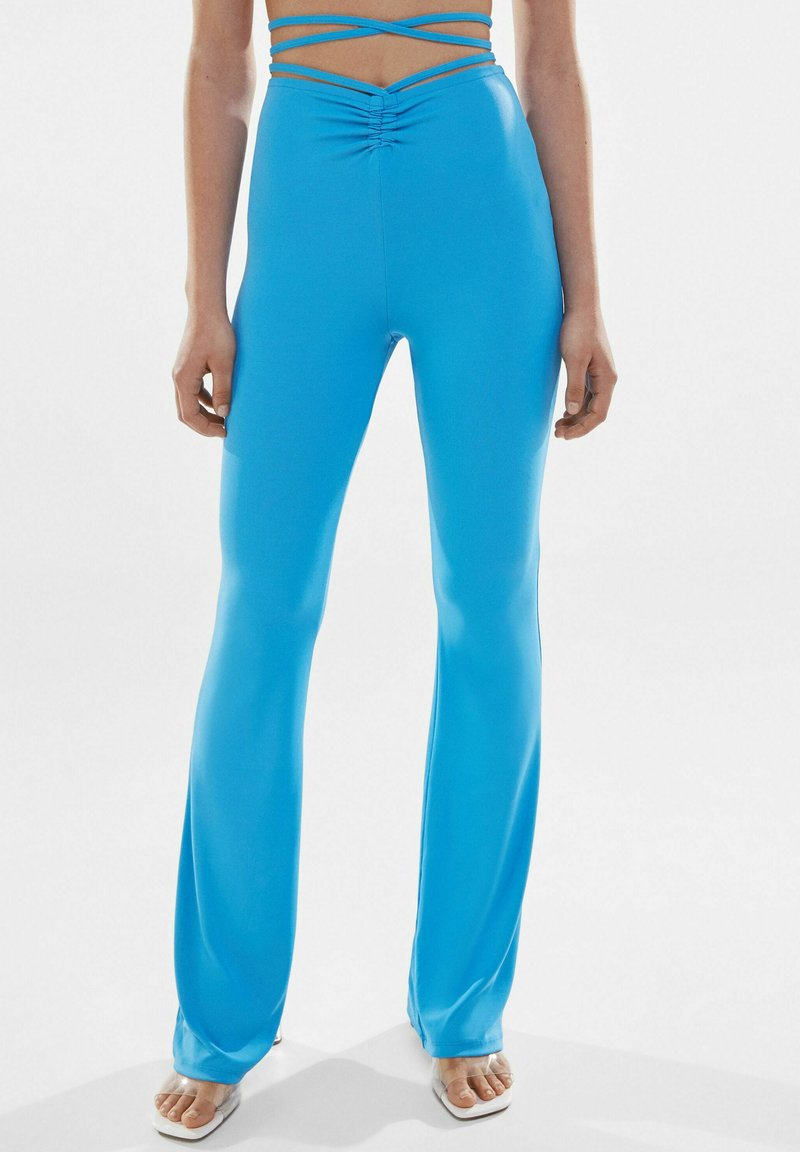 Bershka - Trousers - blue