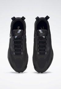 Reebok - AT CRAZE 2.0 FOUNDATION - Zapatillas de trail running - black/grey - 1