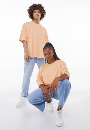 OVERSIZED UNISEX - Basic T-shirt - orange
